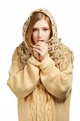 Woman In Woollen Comforter Warming Frozen Hands