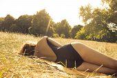 Woman Sunbathing On The Heath