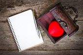 Heart In The  Box And Notebook With A Pen