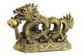 Bronze figurine of dragon with pearl isolated on white