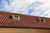 picture of red roof tile  - red tiled roof with garret windows in old town - JPG