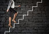stock photo of step-ladder  - Image of businesswoman climbing career ladder - JPG