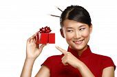 Traditional Asian Girl Showing A Christmas Gift