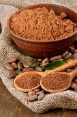 pic of cocoa beans  - Cocoa powder and cocoa beans on wooden background - JPG