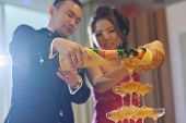 Asian Chinese wedding dinner reception, bride and groom champagne toasting, natural candid photo.