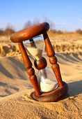hourglass in desert's sand