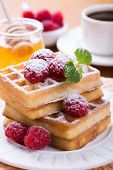 Fresh Belgian Waffles With Raspberries, Honey And Cup Of Coffee