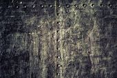 stock photo of stelles  - Closeup of grunge old black metal plate as background or texture - JPG