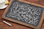 who, what, when, where, why, how questions - brainstorming concept  on a vintage slate blackboard wi