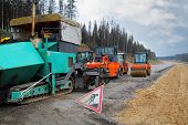 MOSCOW - SEP 20: Special road machinery in the construction of a new highway between Moscow and Sain