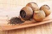 Pu-erh. Chinese Tea Packed In Dried Mandarins On Wooden Table