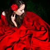 stock photo of cloak  - beautiful woman with red cloak  in the woods in spring - JPG