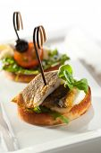 image of canapes  - Fish and Vegetables Canapes over White - JPG