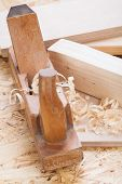 Handheld Wood Plane With Wood Shavings