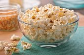 stock photo of maize  - A bowl of freshly popped homemade popcorn - JPG