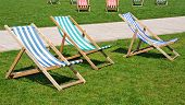 stock photo of avon  - Colourful deckchairs in Bancroft gardens in front of the RSC Stratford - JPG