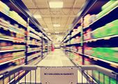 a blurred shot of an isle in a supermarket or grocery store shop done with a retro vintage instagram filter