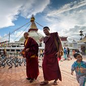 Buddhits Monks, Unidentified Child, Tourists And Pilgrims At Kora around Boudhanath Stupa. Nepal