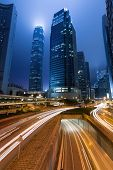 City night scene with cars motion blurred light in Hong Kong, Asia.