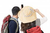 Asian young traveling couple selfie, rear view full length portrait isolated on white background.