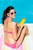 Woman On Summer Vacation Sunbathing With Suntan Lotion