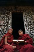 Young Monks Reading A Book At Shwenandaw Monastery In Mandalay,myanmar.