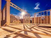picture of framing a building  - New construction of a house - JPG