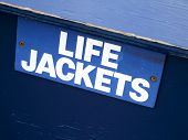 Close-up of a signboard of LIFE JACKETS