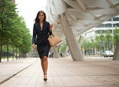 Business Woman Walking In The City With Handbag