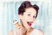 Cool Pin-up Woman In Cold Freezer With Ice-cream