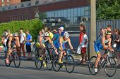 DNEPROPETROVSK, UKRAINE - MAY 24, 2014: Athletes race on the cycling stage of ETU Sprint Triathlon E