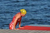 DNEPROPETROVSK, UKRAINE - MAY 24, 2014: Angelina Borodina, Belarus leads after the swimming stage of