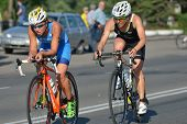 DNEPROPETROVSK, UKRAINE - MAY 24, 2014: Yuliya Yelistratova of Ukraine (left) and Mateja Simic of Slovenia leading in the cycling stage of ETU Sprint Triathlon European cup