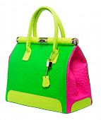 Bright neon pink, green and yellow bag with gold lock and ostrich texture leather isolated on white