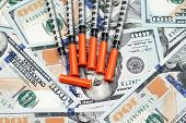 Hypodermic Needles On Hunderd Dollar Bills