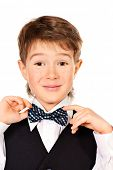 Portrait of a cute 7 year old boy wearing suit and bow-tie. Education. Copy space. Isolated over whi