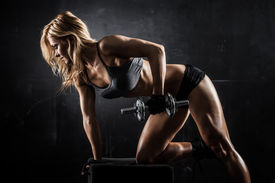 picture of elbow  - Brutal athletic woman pumping up muscles with dumbbells - JPG