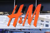 HONG KONG - CIRCA MARCH 2014: H&M fashion store in Hong Kong. H&M Hennes & Mauritz AB (H&M) is a Swedish multinational retail-clothing company.