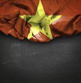 Vietnam waving flag on blackboard