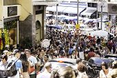 SAO PAULO, BRAZIL - CIRCA MARCH 2014: Hundreds of People walk along the 25 March area in Sao Paulo, Brazil. 25 March is a popular commerce region near the center of Sao Paulo, Brazil.