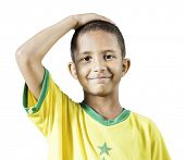 Brazilian little boy putting his hand on his head on white background
