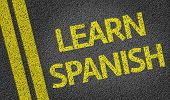 Learn Spanish written on the road