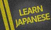 Learn Japanese written on the road
