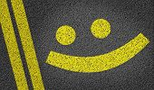 Happy Smiley written on the road