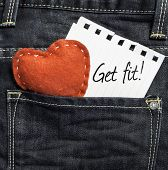 Get Fit written on a peace of paper and a heart on a jeans background