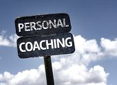 Personal Coaching sign with clouds and sky background
