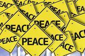 Peace written on multiple road sign