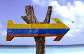 stock photo of medellin  - Colombia wooden sign with a beach on background  - JPG