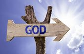 God wooden sign on a beautiful day