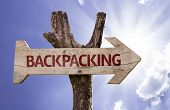 Backpacking wooden sign on a beautiful day